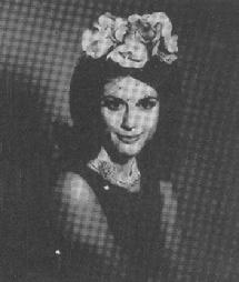 "Bouffant hairstyle of the 1960s topped with a charming floral headpiece with veil (photo from the defunct American magazine ""Hats"" December 1965 issue)"