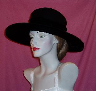 classically styled fine felt hat accented with velvet